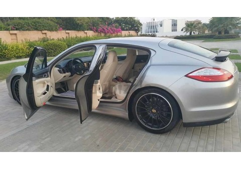 Unique Porsche Panamera 4S with dark blue and beige leather