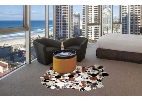 Irregular shaped cowhide patchwork rug